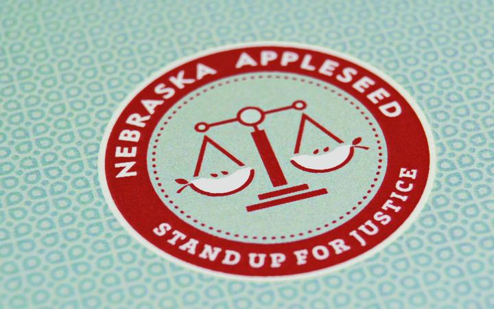 nebraska_appleseed_nonprofit_social-activism_justice_2.5_shield_logo